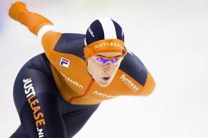 Ireen Wüst in actie op de 1000 meter tijdens de KNSB Cup. © ANP